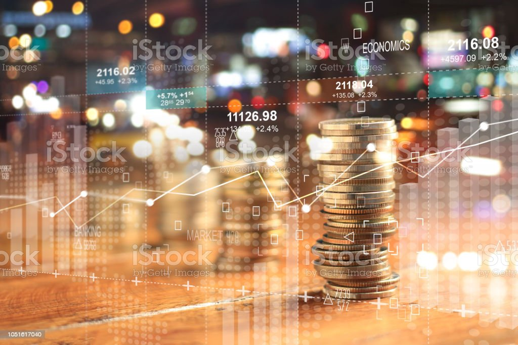 Double explosure with businesss charts of graph and rows of coins for finance at night city background. Double explosure with businesss charts of graph and rows of coins for finance at night city background. Accountancy Stock Photo