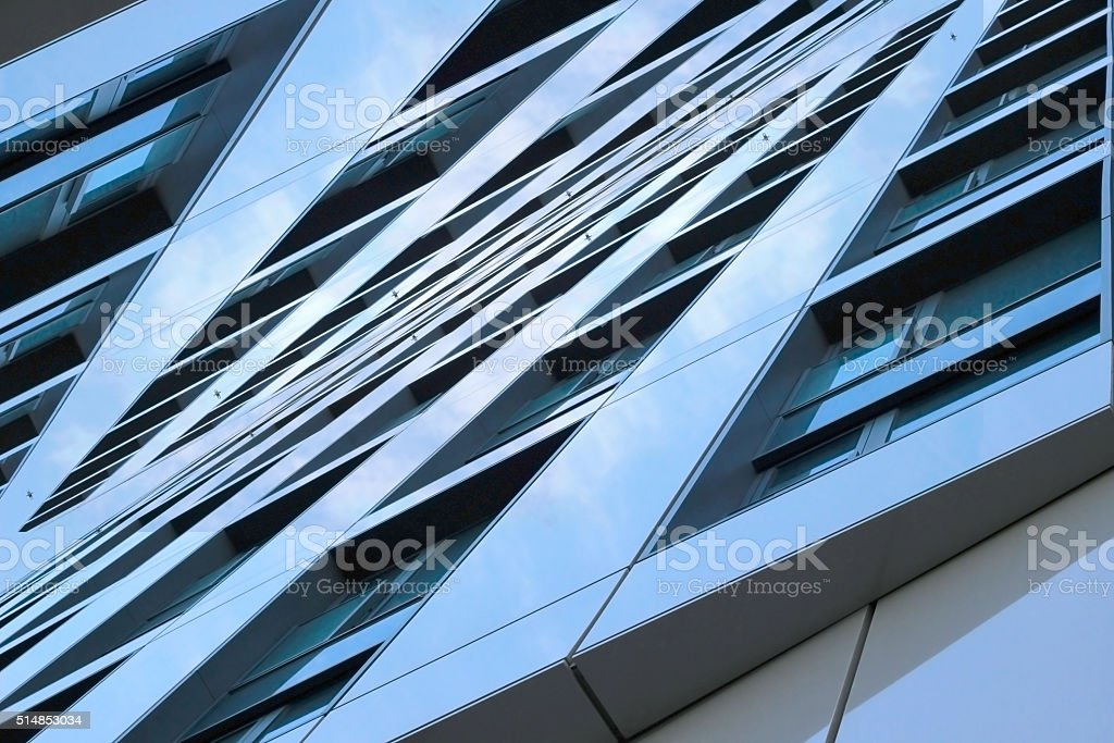 Double exposition photo of contemporary building fragment. Symmetrical urban composition. stock photo