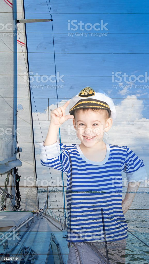 Double exposure a little boy seaman and yacht stock photo