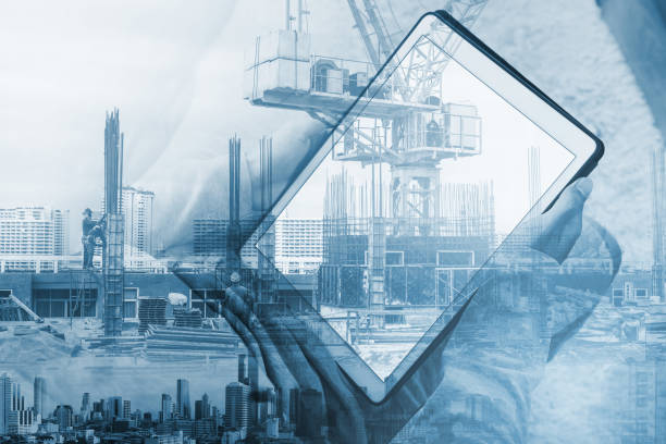 Double exposure, a man using digital tablet and buildings construction with cityscape stock photo