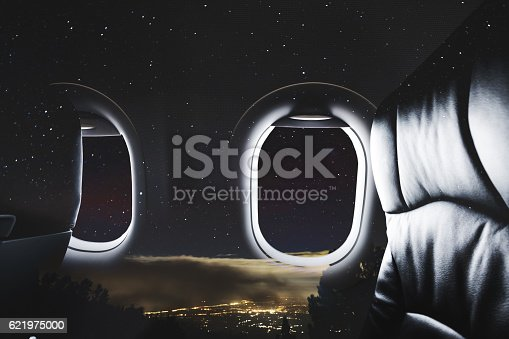 istock Double exposure, Airplane window with seat and night sky 621975000