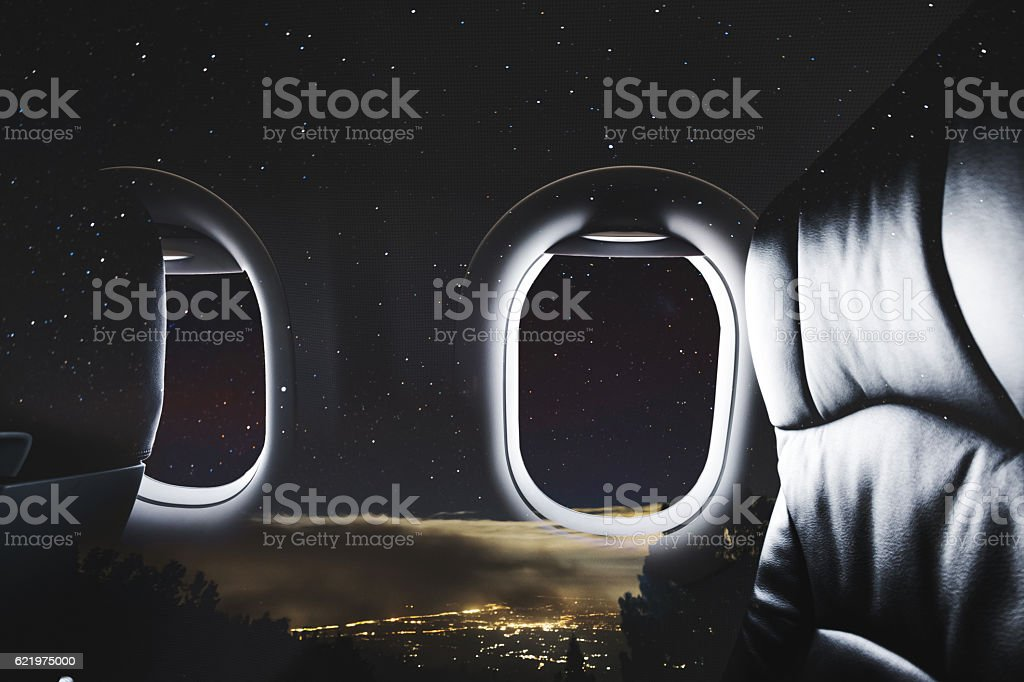Double exposure, Airplane window with seat and night sky stock photo