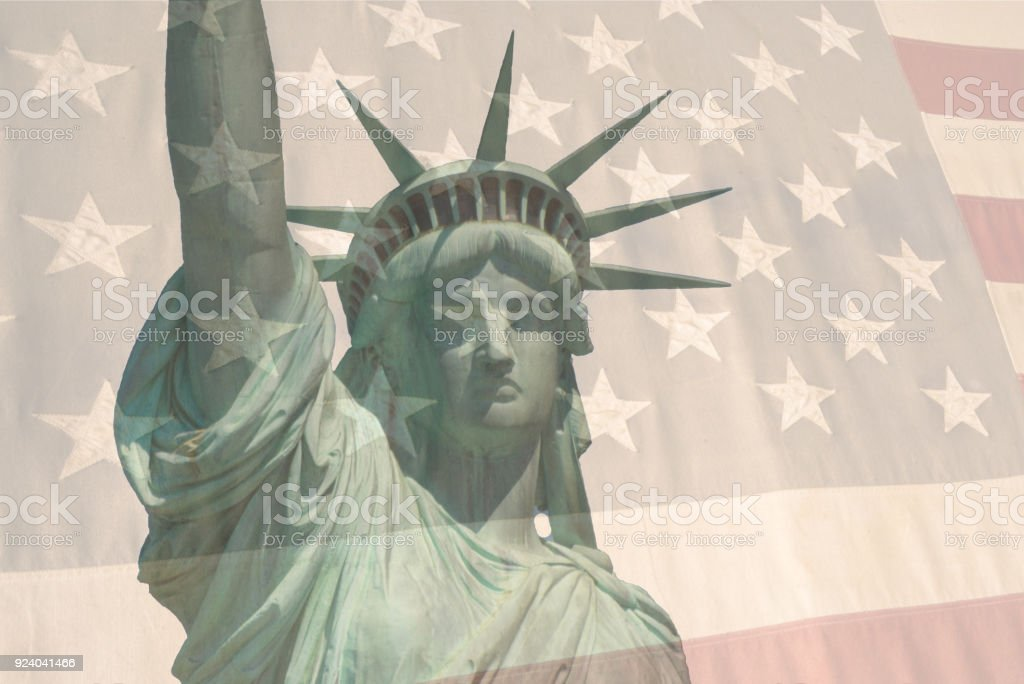 Double exposure American Flag and Statue of Liberty stock photo