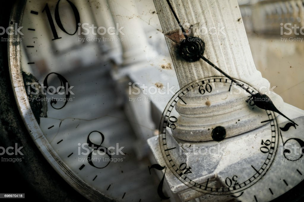 Double exposure: Antique pocket watch and columns stock photo