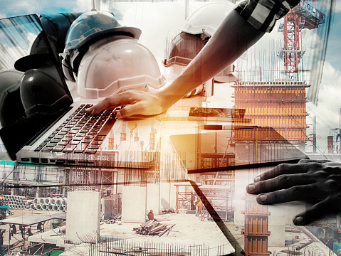 istock Double exposure architect working with laptop and blueprints in workplace for architectural plan,selective focus,Business concept 867395460