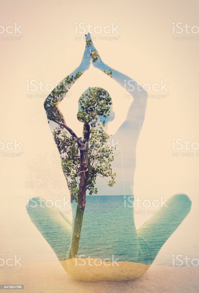 Double Exposure Beach Yoga A double exposure of a woman in a yoga position and a tree on a beach. Beach Stock Photo