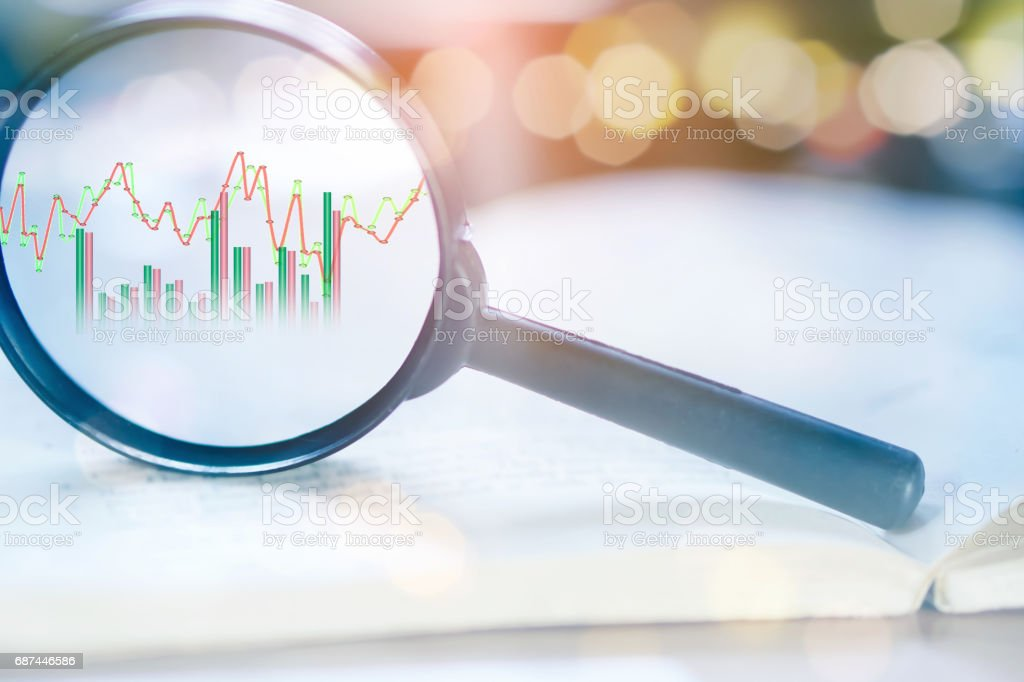 double exposure business concept magnifying glass focus on growth stock graph stock photo