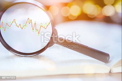 istock double exposure business concept magnifying glass focus on growth stock graph 687447022