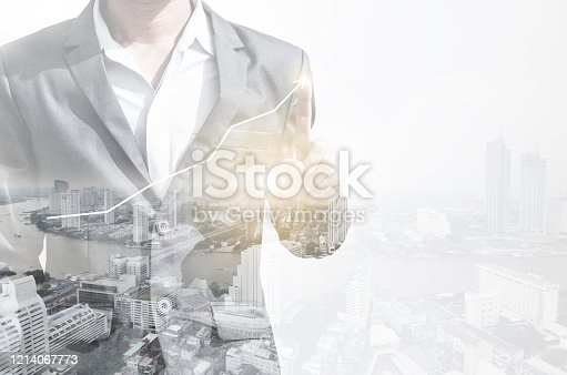 994786356 istock photo double exposure business man draw growth chart with cityscape background. concept for business working and leadership success with strategy plan management idea. 1214067773