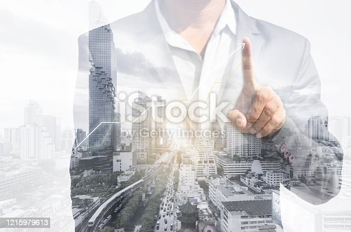 994786356 istock photo double exposure business man draw growth chart with cityscape background. concept for business working and leadership success with strategy plan management idea. 1215979613