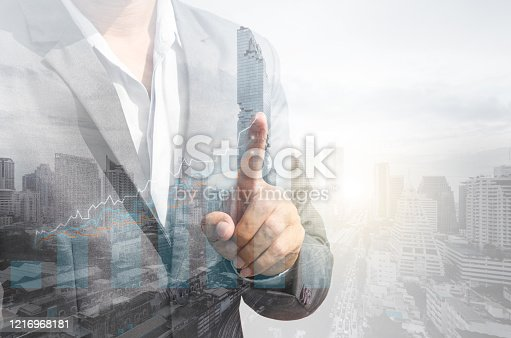 994786356 istock photo double exposure business man draw growth chart with cityscape background. concept for business working and leadership success with strategy plan management idea. 1216968181