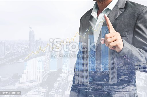 994786356 istock photo double exposure business man draw growth chart with cityscape background. concept for business working and leadership success with strategy plan management idea. 1223018113