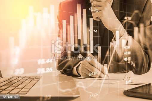 istock Double exposure business man on stock financial exchange. Stock market financial  indices on LED. Economy return earning. Stock market financial overview in market economy. Economy analysis background 682081392
