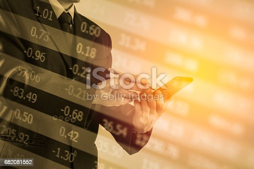 istock Double exposure business man on stock financial exchange. Stock market financial  indices on LED. Economy return earning. Stock market financial overview in market economy. Economy analysis background 682081552