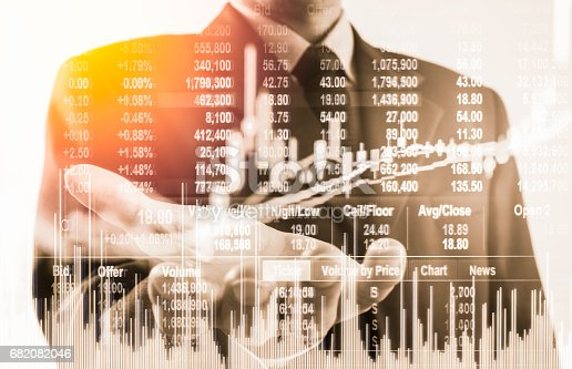 istock Double exposure business man on stock financial exchange. Stock market financial  indices on LED. Economy return earning. Stock market financial overview in market economy. Economy analysis background 682082046