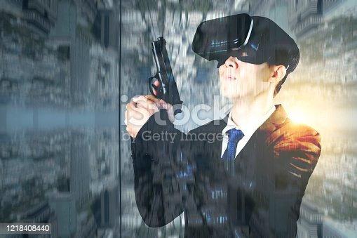 Double exposure business man with a gun wearing VR