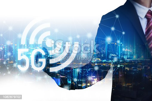 Double exposure 5g mobile network connection concept, Business man with technology graphic wifi and future city background at night