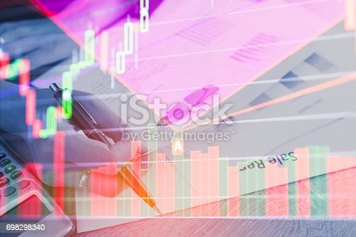 istock Double exposure business people counting making document on stock market financial chart. Stock markets financial or Investment strategy background Business chart concept 698298340