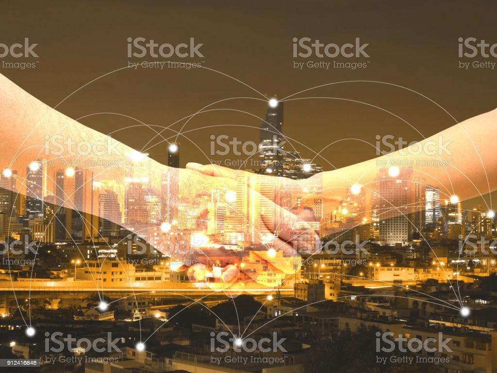 Double exposure business people shaking hands stock photo