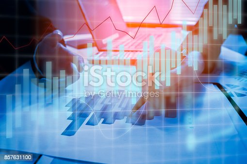 858031152istockphoto Double exposure business people working at office. Stock markets financial or Investment strategy background Business chart concept 857631100