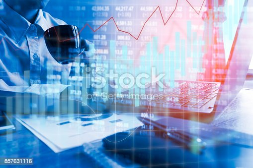 858031152istockphoto Double exposure business people working at office. Stock markets financial or Investment strategy background Business chart concept 857631116
