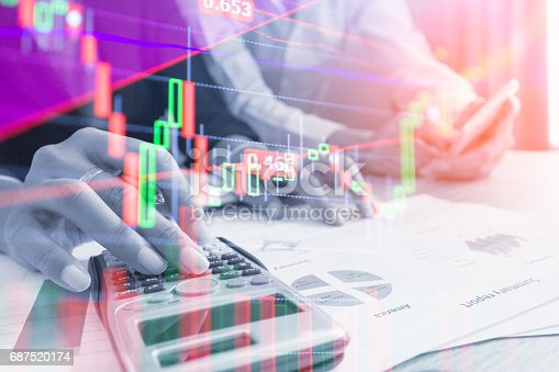 istock Double exposure business team meeting Stock markets financial or Investment strategy background Business chart concept 687520174