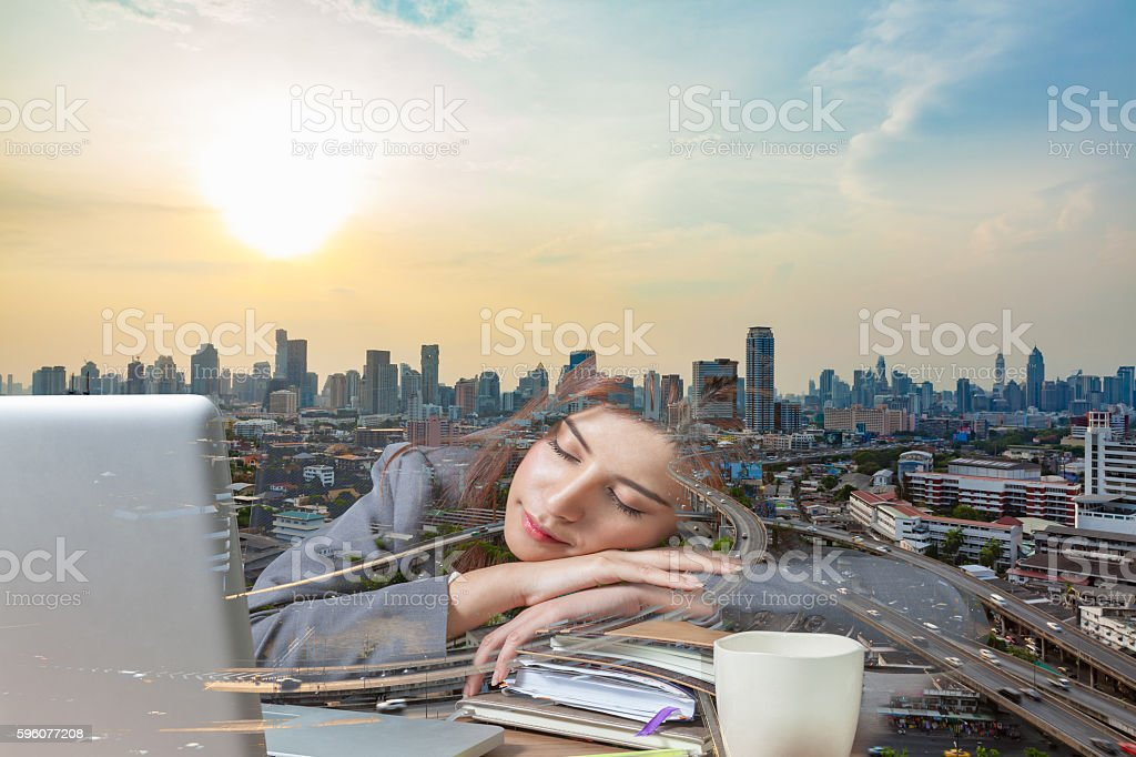 Double exposure business woman sleeping on laptop royalty-free stock photo