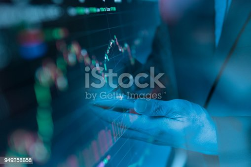 486678786 istock photo Double exposure Businessman finger touching smart phone with finance graph of stock. 949258658