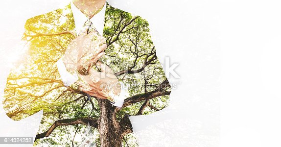 istock Double Exposure Businessman in Suit with Big Tree 614324252