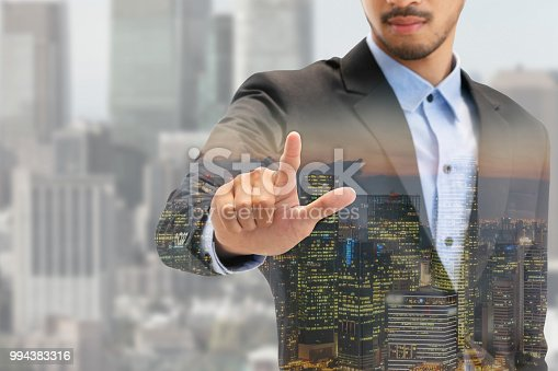 1054574018istockphoto Double exposure businessman pointing at copy space 994383316