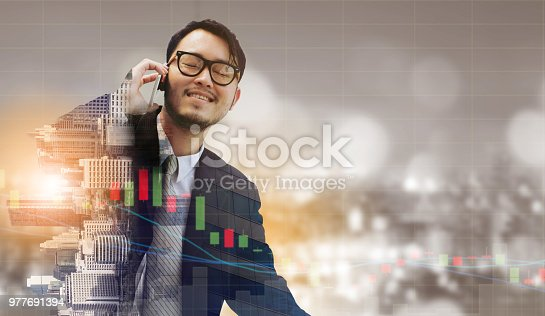 1054574038 istock photo Double exposure businessman using mobile phone. 977691394