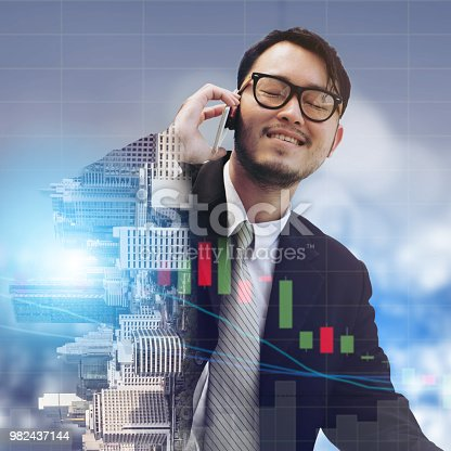 861862204 istock photo Double exposure businessman using mobile phone. 982437144