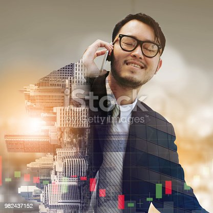 861862204 istock photo Double exposure businessman using mobile phone. 982437152