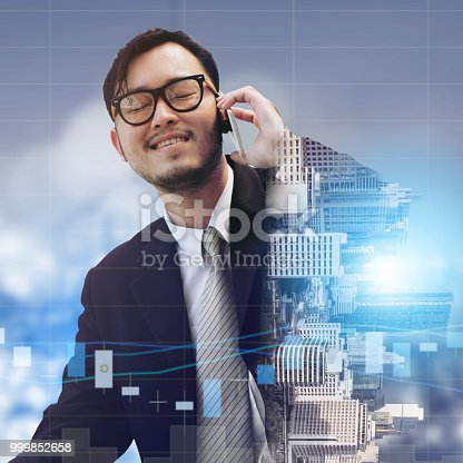861862204 istock photo Double exposure businessman using mobile phone. 999852658