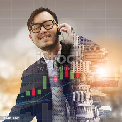 1054574038 istock photo Double exposure businessman using mobile phone. 999852662