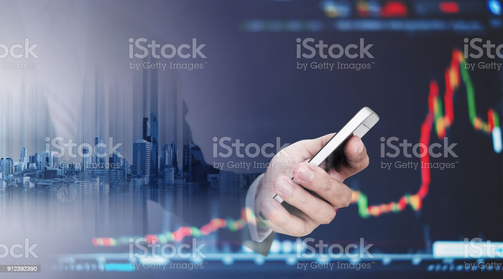 Double exposure Businessman using mobile smart phone with raising graph. Business growth and investment stock photo