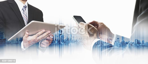 635942136istockphoto Double exposure businessman using smartphone and digital tablet with city 638198616