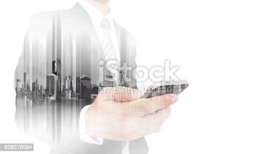 635942136istockphoto Double exposure businessman using smartphone with city, isolated on white 638318094