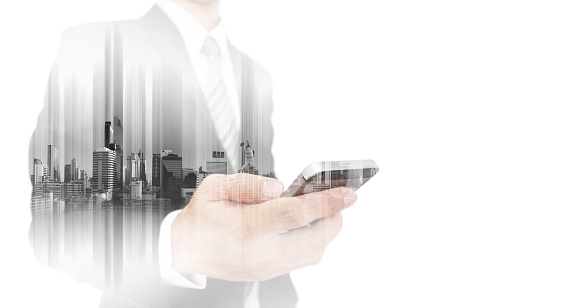 635942136 istock photo Double exposure businessman using smartphone with city, isolated on white 638318094