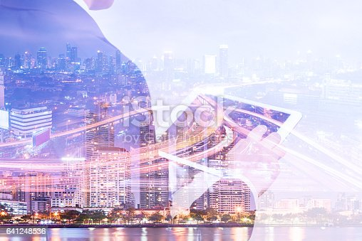istock Double exposure businessman using tablet and cityscape night view 641248536