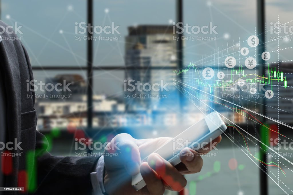 Double exposure businessman using the smart phone and stock market or forex graph royalty-free stock photo