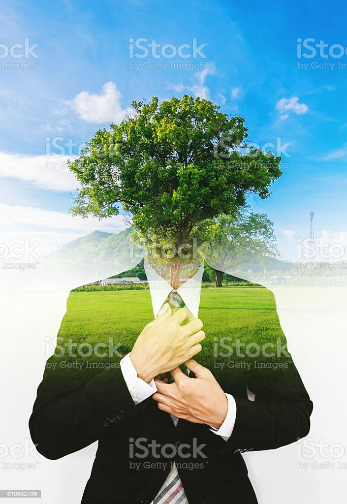 Double exposure businessman with a tree with blue sky stock photo
