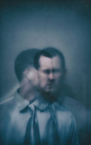 Double exposure businessman with two faces stock photo
