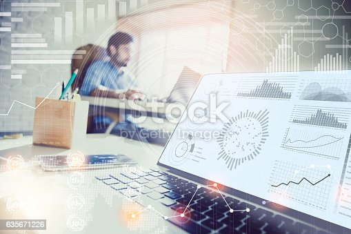 istock Double exposure. businessman working in modern office with modern technology. 635671226