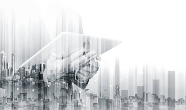 double exposure businessman working on digital tablet with modern buildings. business growth and investment - monochrome stock pictures, royalty-free photos & images