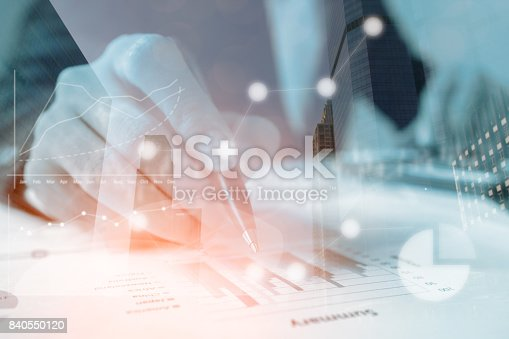 istock Double exposure businessmen working with graph data at office,Finance managers task,Concept business and finance investment 840550120