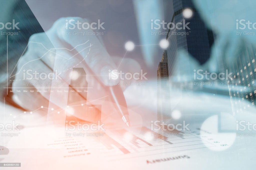 Double exposure businessmen working with graph data at office,Finance managers task,Concept business and finance investment stock photo