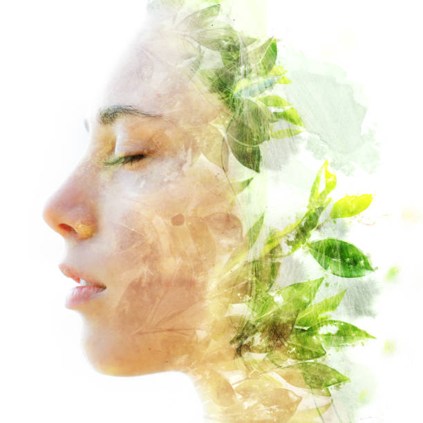 Double exposure close up of a young happy natural beauty and bright shining tropical leaves stock photo