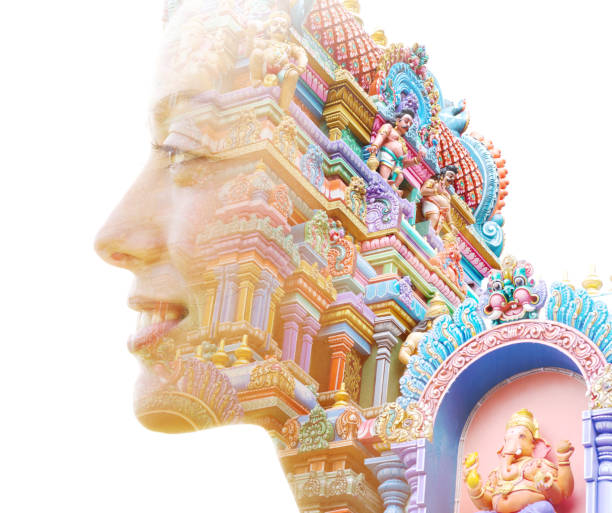 Double exposure close up portrait of an attractive smiling woman combined with a colorful Hindu temple stock photo