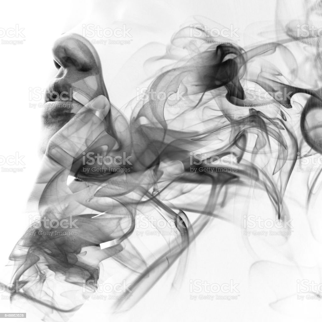 Double exposure closeup of a sensual model gently touching her lips and a monochromatic smoky texture stock photo